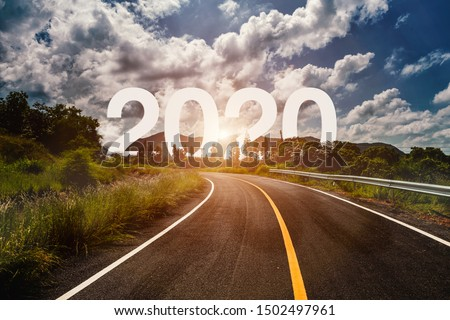 The word 2020 behind the tree of empty asphalt road at golden sunset and beautiful blue sky. Concept for vision year 2020.  #1502497961