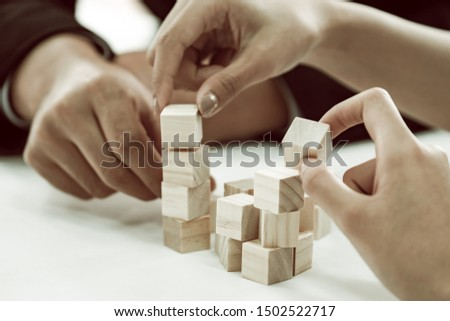 Close-up Of A Businesspeople Arranging Wooden Block On Office Desk business organization startup concept. #1502522717