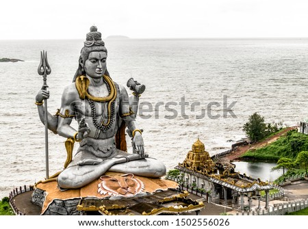 Very Famous and Magnificent statue of Lord Shiva in Murdeshwar, Karnataka. This 123 feet statue is situated on the coast of Arabian sea and is the second tallest statue of God Shiva of Hindu mythology #1502556026