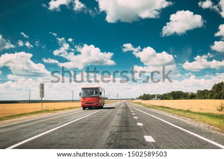 Red Bus In Motion On Country Road. Motion Cars On Freeway In Europe. Asphalt Freeway, Motorway, Highway Through Fields Eastern European Landscape. Travel Concept. #1502589503