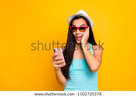 Photo of charming cute funny excited girl seeing new information on her phone held with her hands astonished of sales isolated with bright color background #1502720378