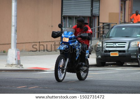 Dirt Motor Bike, Men on mountain motor bike at stop light on Fulton street and Brooklyn ave in the crown heights Brooklyn September 8, 2019 #1502731472