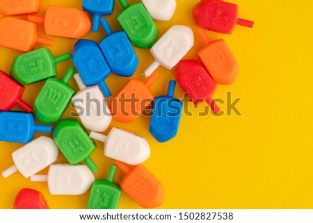 Dreidels used for a game during the Jewish holiday of Hanukkah. A way to celebrate Chanukah and Judaism during the Hebrew holidays.