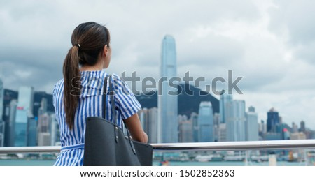 Woman look around the beautiful view in Hong Kong  #1502852363