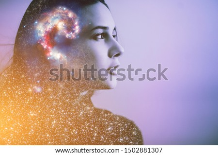 Double multiply exposure abstract portrait of a dreamer cute young woman face with galaxy universe space inside head. Spirit cosmos astronomy life zen concept Elements of this image furnished by NASA #1502881307