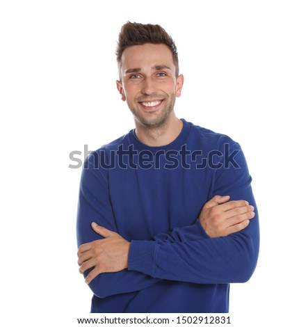 Happy young man in blue sweatshirt on white background. Winter season #1502912831