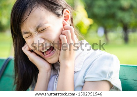 Annoyed woman covering ears with forefingers feel hurt ear ache pain otitis from loud noise sound,noisy music or anxiety asian child girl with schizophrenia suffer from mental pain,hearing things #1502951546