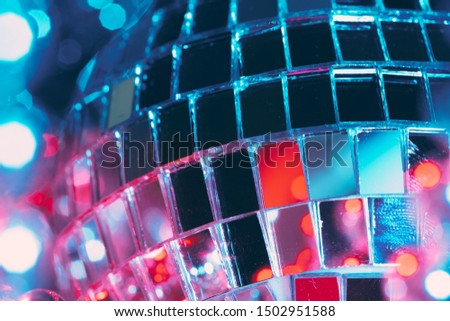 Shiny disco party background with mirror balls reflecting light #1502951588