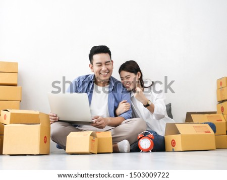 Asian couple with stack of parcel boxes, online business and delivery concept. #1503009722