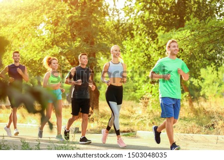 Group of sporty young people running outdoors #1503048035