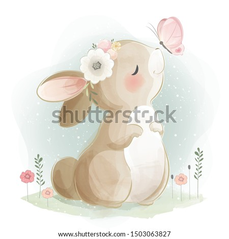 Cute Bunny Playing with Butterfly Royalty-Free Stock Photo #1503063827