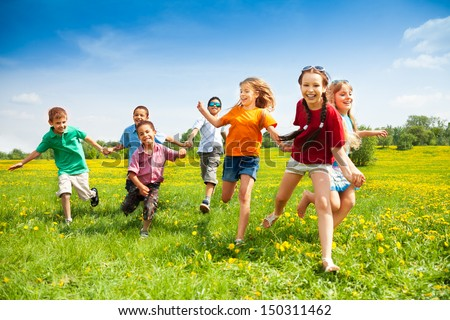 Large group of children running in the dandelion spring field #150311462