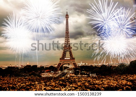 celebrating the New Year in Paris Eiffel tower with fireworks #1503138239