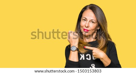 Beautiful middle age woman wearing rock and roll sweater In hurry pointing to watch time, impatience, upset and angry for deadline delay #1503153803