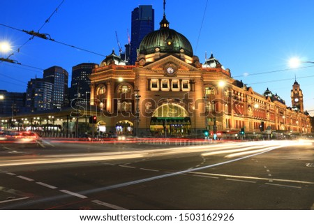 Night photo of Melbourne's iconic Flinders train station with light trails of vehicle taken by long exposure. Australia beautiful places and monuments to see for tourists. #1503162926