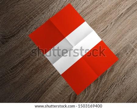 Flag of Austria on paper. Austria Flag on wooden table. #1503169400