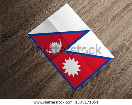 Flag of Nepal on paper. Nepal Flag on wooden table. #1503171851