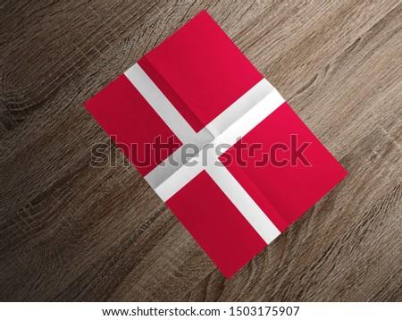 Flag of Denmark on paper. Denmark Flag on wooden table. #1503175907
