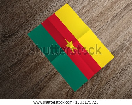 Flag of Cameroon on paper. Cameroon Flag on wooden table. #1503175925