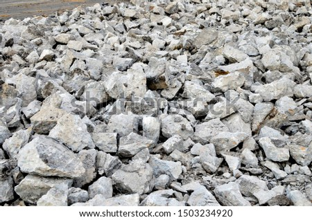 Recycling and reuse crushed concrete rubble, asphalt, building material, blocks. Broken concrete slabs at construction site. Сoncrete rubble from demolition at landfill. Hardcore waste recycling #1503234920