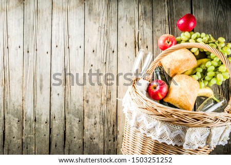 Picnic basket with food and drinks (fresh fruits, bread and wine bottle, glasses), copy space #1503251252
