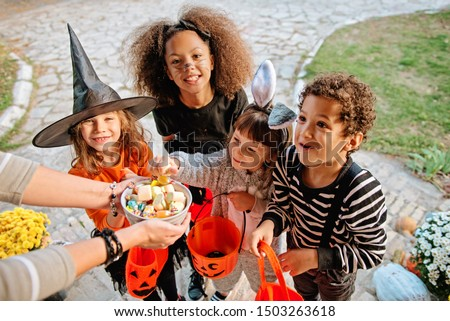 Children in Halloween costumes, trick or treating  #1503263618