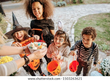 Children in Halloween costumes, trick or treating  #1503263621