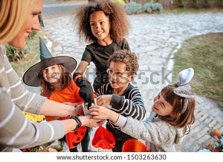 Children in Halloween costumes, trick or treating  #1503263630