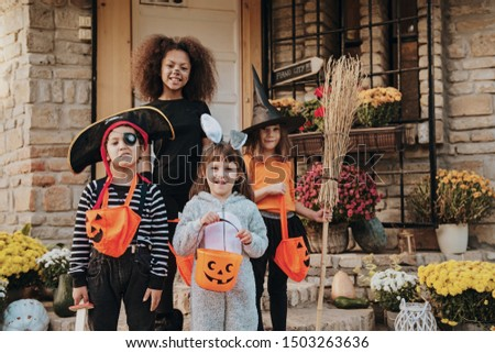 Children in Halloween costumes, trick or treating  #1503263636