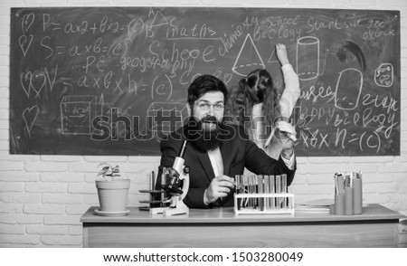 Explaining biology to children. Man bearded teacher work with microscope and test tubes in biology classroom. Biology plays role in understanding of complex forms of life. School teacher of biology. #1503280049