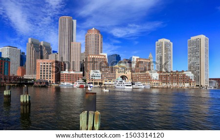 Colorful Boston skyline early morning with skyscraper reflections into the ocean, Massachusetts, USA