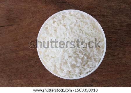 Thai jasmine rice in white bowl top.Steam rice for health #1503350918
