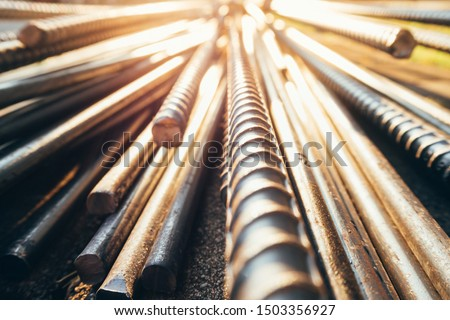 close up steel bar or steel reinforcement bar in the construction site with sunbeam at the morning, steel rods bars can use for reinforce concrete.  #1503356927