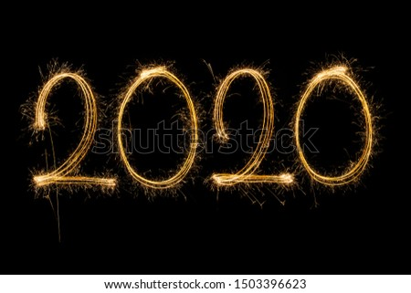 Happy New Year 2020. Creative text Happy New Year 2020 written sparkling sparklers isolated on black background for design #1503396623