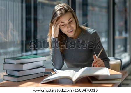 Caucasian young teacher girl preparing for class in school public library #1503470315