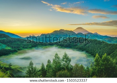 A Mysterious Mist on the Top of Dieng Mountain and A Beautiful Sunrise; To enjoy this view, we need 2 hours hiking to the top of Mt. Brahma. #1503523337