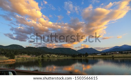Breathtaking sunset view in late summer.  Estes Lake, Rocky Mountain National Park, Colorado, USA.  Reflection in water of colorful clouds, blue sky and mountains.  #1503566615