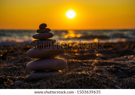 Zen concept. The object of the stones on the beach at sunset. Harmony & Meditation. Zen stones. #1503639635