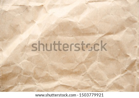 Flat lay craft paper texture. Crumpled cream paper background #1503779921