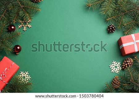 Frame made of Christmas decorations on green background, top view with space for text. Winter season #1503780404