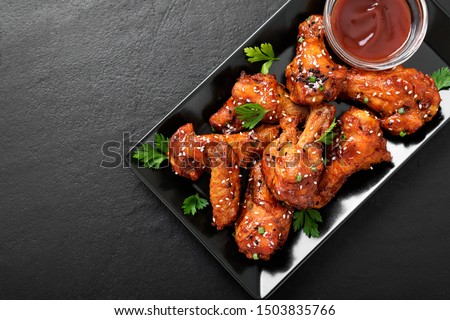 Baked chicken wings with sesame and sauce. Traditional asian recipe.  #1503835766
