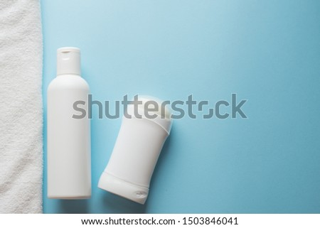 deodorant, lotion and towel on blue background , copy space, template #1503846041