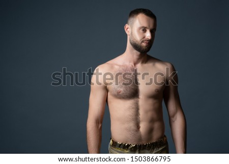 Hairy male chest shaved on one half. Unshaven man's body. The man shaves his belly and breasts. #1503866795