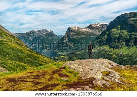 Young man looking on Panorama of Beautiful  landscape view Geirangerfjord  region in More og Romsdal county in Norway. #1503876566