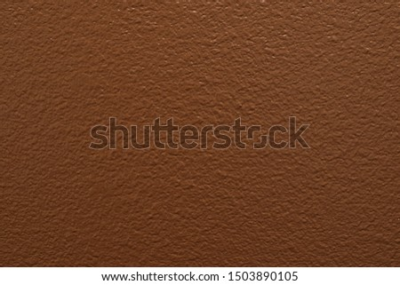 Solid chocolate brown paint color on a section of drywall. #1503890105