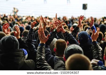 Football fans clapping on the podium of the stadium #1503934307