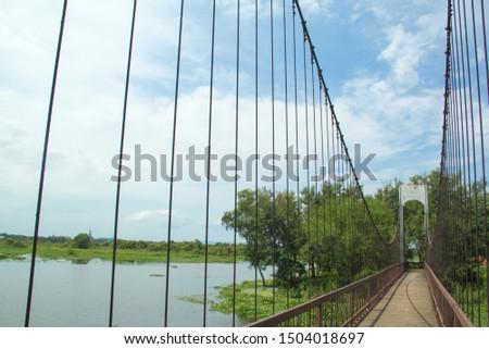 Ancient suspension bridge,Suspension bridge and blue sky. #1504018697