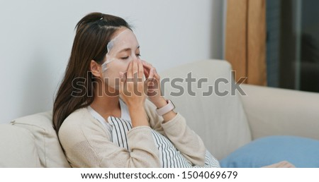 Woman apply facial mask on face at home #1504069679