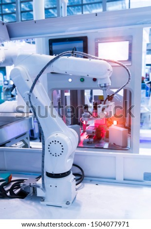 Automation system control application on automate robot arm in smart manufacturing background. #1504077971