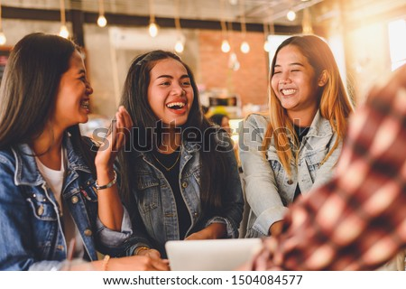 Portrait of cheerful young friends in Cafe Multiracial happy young people laughing enjoying meal having fun sitting together.pleasant conversation during coffee break. #1504084577